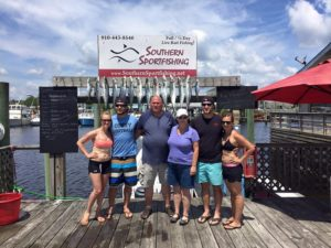 Happy family with their fresh catch after a Carolina Beach fishing charter with Southern Sportfishing